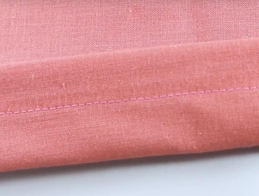 Wonderfil Iron n Fuse limtråd brukt i overlock.